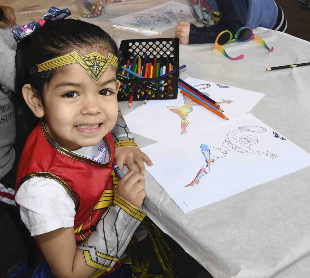 Zoo-goers visiting the event's arts and crafts table were able to make their own comics and enjoy superhero coloring pages.